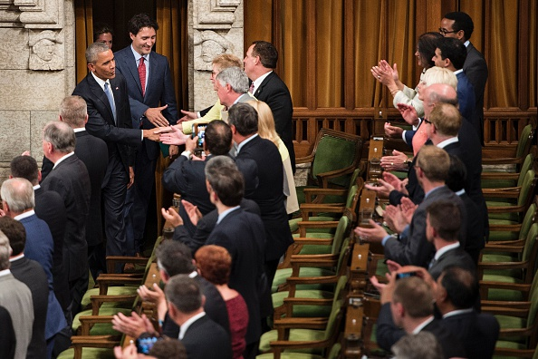 US President Barack Obama (L) arrives with Canadian Prime Minister Justin Trudeau (2L) to address Parliament in the House of Commons Chamber on Parliament Hill while attending the North American Leaders Summit on June 29, 2016 in Ottawa, Ontario. / AFP / Brendan Smialowski (Photo credit should read BRENDAN SMIALOWSKI/AFP/Getty Images)