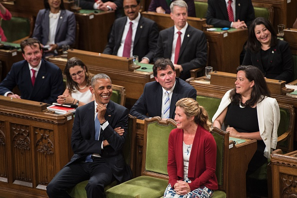US President Barack Obama (L) confers with Sophie Gregoire Trudeau before addressing Parliament in the House of Commons Chamber on Parliament Hill during the North American Leaders Summit on June 29, 2016 in Ottawa, Ontario. / AFP / Brendan Smialowski (Photo credit should read BRENDAN SMIALOWSKI/AFP/Getty Images)