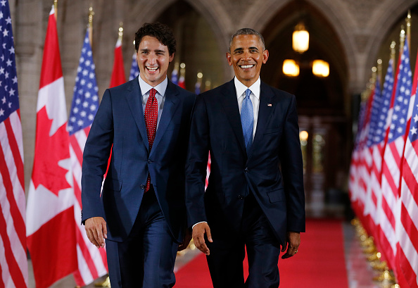 Prime Minister of Canada Justin Trudeau (L) and US President Barack Obama exit the Hall of Honour on Parliament Hill following the North American Leaders Summit in Ottawa, June 28, 2016. / AFP / Chris Roussakis (Photo credit should read CHRIS ROUSSAKIS/AFP/Getty Images)