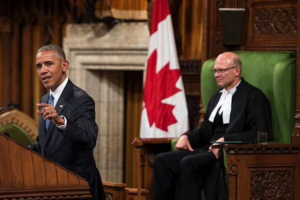 US President Barack Obama addresses Parliament in the House of Commons Chamber on Parliament Hill while attending the North American Leaders Summit and Leaders Summit June 29, 2016 in Ottawa, Ontario. / AFP / Brendan Smialowski (Photo credit should read BRENDAN SMIALOWSKI/AFP/Getty Images)