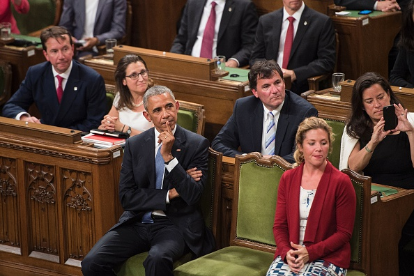 US President Barack Obama (L) waits with Sophie Gregoire Trudeau before addressing Parliament in the House of Commons Chamber on Parliament Hill while attending the North American Leaders Summit June 29, 2016 in Ottawa, Ontario. / AFP / Brendan Smialowski (Photo credit should read BRENDAN SMIALOWSKI/AFP/Getty Images)