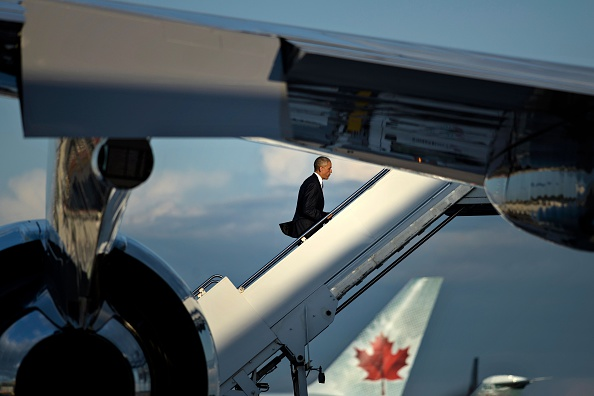 US President Barack Obama boards Air Force One at Ottawa Macdonald-Cartier International Airport after the North American Leaders Summit on June 29, 2016 in Ottawa, Ontario. / AFP / Brendan Smialowski (Photo credit should read BRENDAN SMIALOWSKI/AFP/Getty Images)