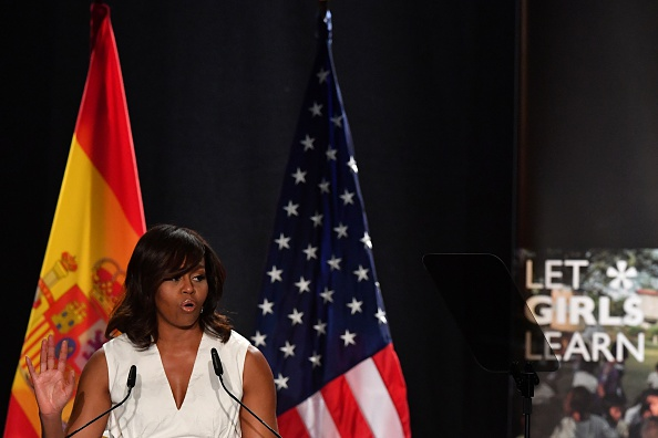 "US first lady Michelle Obama gestures as she delivers a speech presenting the ""Let Girls Learn"" initiative on June 29, 2016 in Madrid. US First Lady Michelle Obama began a two day visit to Spain by delivering a speech on the education initiative launched in March 2015 to help adolescent girls across the world access a quality education. / AFP / GERARD JULIEN (Photo credit should read GERARD JULIEN/AFP/Getty Images)"