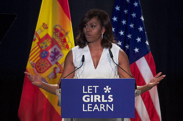 """MADRID, SPAIN - JUNE 30: US First Lady Michelle Obama attends the presentation of """"Let Girls Learn"""" at Matadero cultural center on June 30, 2016 in Madrid, Spain. In this initiative Michelle Obama shares the stories of girls she has met in her prior travels and highlights new commitments to support """"Let Girls Learn"""". Mrs. Obama encourage the audience to value their own educational opportunities, continue to strive for progress for girls and young women in their country, and take action to help the more than 62 million girls around the world who are out of school. (Photo by Carlos Alvarez/Getty Images)"""
