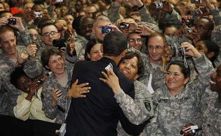 President Barack Obama hugs a soldier as he greets military personnel at Camp Victory in Baghdad, Iraq, Tuesday, April 7, 2009. (AP Photo/Charles Dharapak)