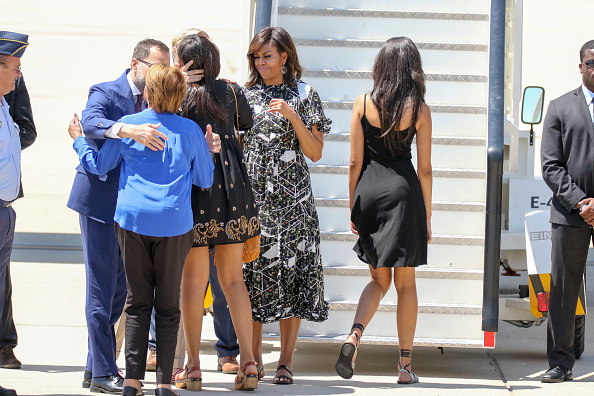 MADRID, SPAIN - JULY 01: US First Lady Michelle Obama (2R), her daughters Malia Obama (R) and Sasha Obama (3L) and her mother Marian Robinson (2L) board an official plane prior to her departure from Torrejon Air Force Base on July 1, 2016 in Madrid, Spain. The First Lady delivered a speech on Let Girls Learn to girls and young women, sharing the stories of girls she has met during her travels and highlighting new commitments to support Let Girls Learn. Mrs. Obama encouraged the audience to value their own educational opportunities, continue to strive for progress for girls and young women in their country, and take action to help the more than 62 million girls around the world who are out of school on July 1, 2016 in Madrid, Spain. (Photo by Europa Press/Europa Press via Getty Images)