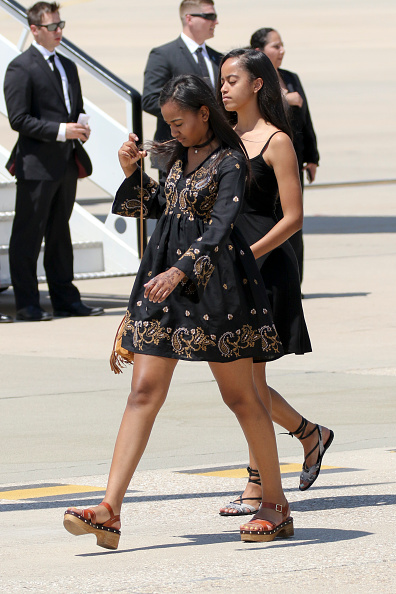 MADRID, SPAIN - JULY 01: US First Lady Michelle Obama's daughters Malia Obama (R) and Sasha Obama (L) board an official plane prior to her departure from Torrejon Air Force Base on July 1, 2016 in Madrid, Spain. The First Lady delivered a speech on Let Girls Learn to girls and young women, sharing the stories of girls she has met during her travels and highlighting new commitments to support Let Girls Learn. Mrs. Obama encouraged the audience to value their own educational opportunities, continue to strive for progress for girls and young women in their country, and take action to help the more than 62 million girls around the world who are out of school on July 1, 2016 in Madrid, Spain. (Photo by Europa Press/Europa Press via Getty Images)