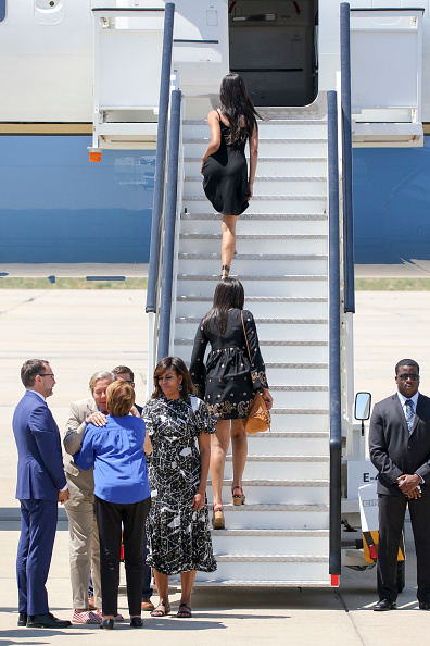 MADRID, SPAIN - JULY 01: US First Lady Michelle Obama (3R), her daughters Malia Obama (R) and Sasha Obama (2L) and her mother Marian Robinson (2L) board an official plane prior to her departure from Torrejon Air Force Base on July 1, 2016 in Madrid, Spain. The First Lady delivered a speech on Let Girls Learn to girls and young women, sharing the stories of girls she has met during her travels and highlighting new commitments to support Let Girls Learn. Mrs. Obama encouraged the audience to value their own educational opportunities, continue to strive for progress for girls and young women in their country, and take action to help the more than 62 million girls around the world who are out of school on July 1, 2016 in Madrid, Spain. (Photo by Europa Press/Europa Press via Getty Images)