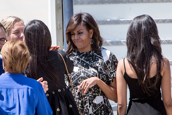 MADRID, SPAIN - JULY 01: US First Lady Michelle Obama boards an official plane prior to her departure from Torrejon Air Force Base on July 1, 2016. in Madrid, Spain. The First Lady delivered a speech on Let Girls Learn to girls and young women, sharing the stories of girls she has met during her travels and highlighting new commitments to support Let Girls Learn. Mrs. Obama encouraged the audience to value their own educational opportunities, continue to strive for progress for girls and young women in their country, and take action to help the more than 62 million girls around the world who are out of school. (Photo by Pablo Cuadra/Getty Images)