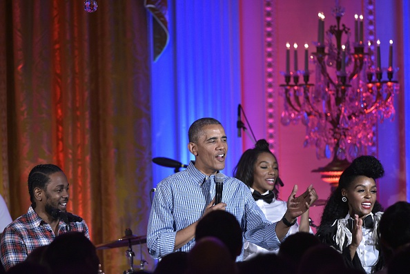 "US President Barack Obama (C) stands with performers Kendrick Lamar (L) and Janelle Monáe (R) and sings ""Happy Birthday"" for his daughter Malia during an Independence Day Celebration for military members and administration staff on July 4, 2016 in the East Room of the White House in Washington, DC. / AFP / Mandel Ngan (Photo credit should read MANDEL NGAN/AFP/Getty Images)"