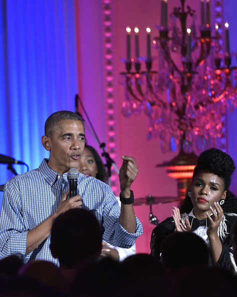 Janelle Monáe (R) applauds as US President Barack Obama speaks during an Independence Day Celebration for military members and administration staff on July 4, 2016 in the East Room of the White House in Washington, DC. / AFP / Mandel Ngan (Photo credit should read MANDEL NGAN/AFP/Getty Images)