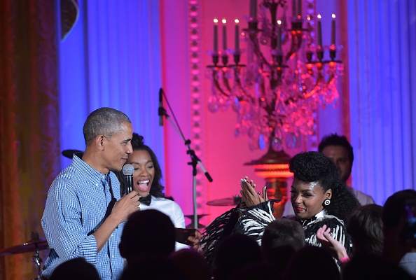 Singer Janelle Monáe (R) applauds as US President Barack Obama speaks during an Independence Day Celebration for military members and administration staff on July 4, 2016 in the East Room of the White House in Washington, DC. / AFP / Mandel NGAN (Photo credit should read MANDEL NGAN/AFP/Getty Images)