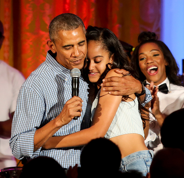 WASHINGTON, DC - JULY 4: President Barack Obama hugs his daughter Malia Obama at the Fourth of July White House party on July 4, 2016 in Washington, DC. Maila Obama celebrated her 18th birthday during the party, which featured guests including singers Janelle Monae and Kendrick Lamar. (Photo by Aude Guerrucci-Pool/Getty Images)