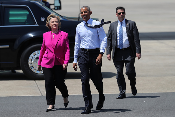 Democratic presidential candidate former Secretary of State Hillary Clinton walks off of Air Force One with U.S. president Barack Obama on July 5, 2016 in Charlotte, North Carolina. Hillary Clinton is campaigning with president Obama in North Carolina.