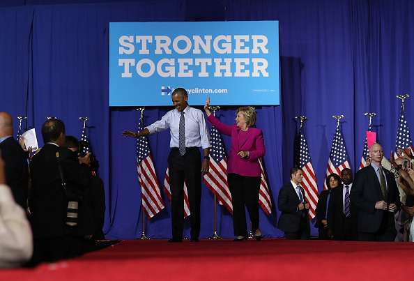CHARLOTTE, NC - JULY 05: Democratic presidential candidate Hillary Clinton and U.S. President Barack Obama greet supporters during a campaign rally on July 5, 2016 in Charlotte, North Carolina. Today is President Obama's first appearance on the campaign trail with Clinton. (Photo by Justin Sullivan/Getty Images)