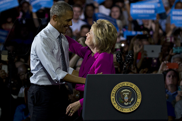 Hillary Clinton, presumptive 2016 Democratic presidential nominee, right, embraces U.S. President Barack Obama during a campaign rally at the Charlotte Convention Center in Charlotte, North Carolina, U.S., on Tuesday, July 5, 2016. Obama, making his debut campaign appearance on Clinton's behalf, flew with her on Air Force One as a show of unity and power hours after the FBI director called Clinton's handling of sensitive e-mails as Secretary of State extremely careless. Photographer: Andrew Harrer/Bloomberg via Getty Images