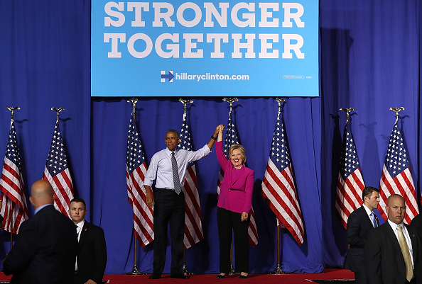 CHARLOTTE, NC - JULY 05: Democratic presidential candidate former Secretary of State Hillary Clinton (R) and U.S. president Barack Obama greet supporters during a campaign rally on July 5, 2016 in Charlotte, North Carolina. Hillary Clinton is campaigning with president Obama in North Carolina. (Photo by Justin Sullivan/Getty Images)