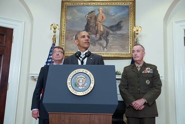 """US President Barack Obama delivers a statement on Afghanistan with Defense Secretary Ashton Carter (L) and the Chairman of the Joint Chiefs of Staff Gen. Joseph Dunford at the White House in Washington, DC, on July 6, 2016. Obama announced that 8,400 US troops will remain in Afghanistan into 2017 in light of the still """"precarious"""" security situation in the war-ravaged country. / AFP / NICHOLAS KAMM (Photo credit should read NICHOLAS KAMM/AFP/Getty Images)"""