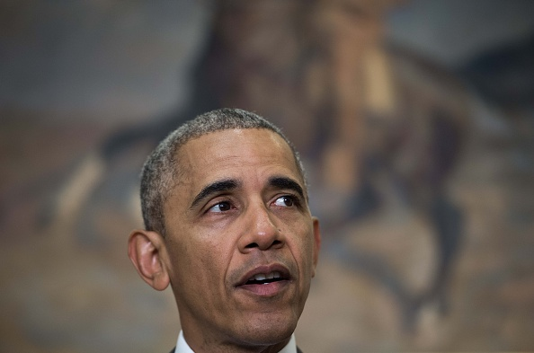 """US President Barack Obama delivers a statement on Afghanistan at the White House in Washington, DC, on July 6, 2016. Obama announced that 8,400 US troops will remain in Afghanistan into 2017 in light of the still """"precarious"""" security situation in the war-ravaged country. / AFP / NICHOLAS KAMM (Photo credit should read NICHOLAS KAMM/AFP/Getty Images)"""