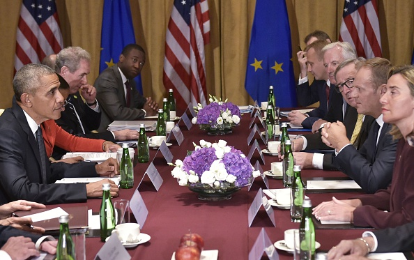 US President Barack Obama (L) meets European Council President Donald Tusk (3rdR), European Commission President Jean-Claude Juncker (4thR) and EU High Representative for Foreign Affairs and Security Federica Mogherini (R) on the sidelines of the NATO Summit at a hotel in Warsaw on July 8, 2016. The Polish capital hosts a two-day NATO summit, the first time ever that it hosts a top-level meeting of the Western military alliance which it joined in 1999. / AFP / MANDEL NGAN (Photo credit should read MANDEL NGAN/AFP/Getty Images)