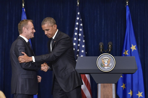 US President Barack Obama (R) shakes hands with European Council President Donald Tusk following a meeting on the sidelines of the NATO Summit at a hotel in Warsaw on July 8, 2016. The Polish capital hosts a two-day NATO summit, the first time ever that it hosts a top-level meeting of the Western military alliance which it joined in 1999. / AFP / MANDEL NGAN (Photo credit should read MANDEL NGAN/AFP/Getty Images)