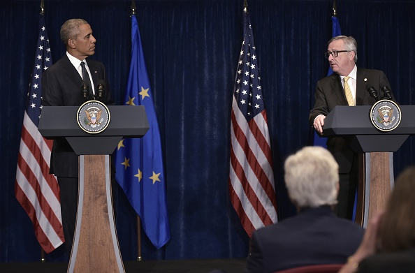 European Commission President Jean-Claude Juncker (R) speaks while looking at US President Barack Obama during a press conference for the joint press statements following a meeting on the sidelines of the NATO Summit at a hotel in Warsaw on July 8, 2016. The Polish capital hosts a two-day NATO summit, first time that it hosts a top-level meeting of the Western military alliance since it joined in 1999. / AFP / MANDEL NGAN (Photo credit should read MANDEL NGAN/AFP/Getty Images)