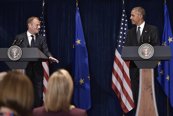 European Council President Donald Tusk (L) speaks while looking at US President Barack Obama during a press conference for the joint press statements following a meeting on the sidelines of the NATO Summit at a hotel in Warsaw on July 8, 2016. The Polish capital hosts a two-day NATO summit, first time that it hosts a top-level meeting of the Western military alliance since it joined in 1999. / AFP / MANDEL NGAN (Photo credit should read MANDEL NGAN/AFP/Getty Images)