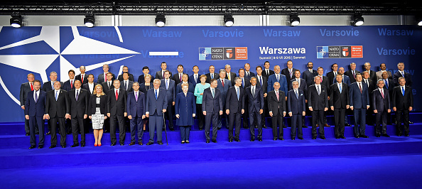 German Chancellor Angela Merkel (2nd row C), Poland's President Andrzej Duda (Bottom, C Left), NATO Secretary General Jens Stoltenberg (Bottom C) and US President Barack Obama (Bottom C Right) pose for a family photo besides other participants, during the NATO summit in Warsaw, Poland, on July 8, 2016. The Polish capital Warsaw hosts a two-day top-level NATO meeting, first time since Poland joined the alliance in 1999. / AFP / JANEK SKARZYNSKI (Photo credit should read JANEK SKARZYNSKI/AFP/Getty Images)