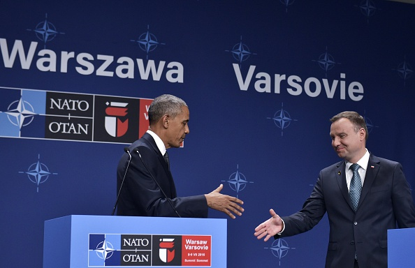 US President Barack Obama (L) and Poland's President Andrzej Duda (R) shake hands during a press conference following a bilateral meeting on the sidelines of the NATO Summit in Warsaw, Poland, on July 8, 2016. The Polish capital Warsaw hosts a two-day top-level NATO meeting, first time since Poland joined the alliance in 1999. / AFP / MANDEL NGAN (Photo credit should read MANDEL NGAN/AFP/Getty Images)