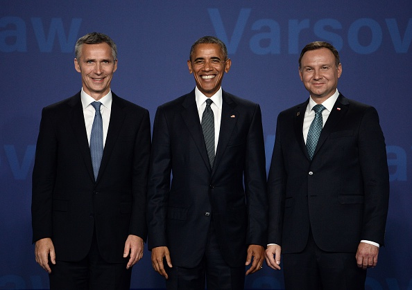 Poland's President Andrzej Duda (R), NATO Secretary General Jens Stoltenberg (L) and US President Barack Obama (C) pose for a picture prior to the opening of the NATO summit on July 8, 2016 at the Belweder Palace in Warsaw, Poland. The Polish capital Warsaw hosts a two-day top-level NATO meeting, for the first time since Poland joined the alliance in 1999. / AFP / STEPHANE DE SAKUTIN (Photo credit should read STEPHANE DE SAKUTIN/AFP/Getty Images)