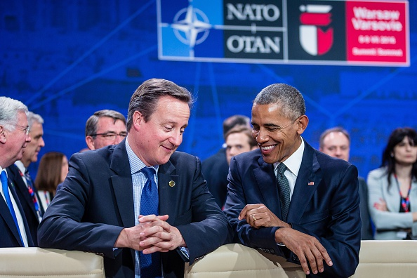 US President Barack Obama (R) and Great Britain's Prime Minister David Cameron (L) chat prior to the meeting of the heads of states of the North Atlantic Council (NAC), during the NATO summit in Warsaw, Poland. The Polish capital Warsaw hosts a two-day top-level NATO meeting, first time since Poland joined the alliance in 1999. / AFP / WOJTEK RADWANSKI (Photo credit should read WOJTEK RADWANSKI/AFP/Getty Images)