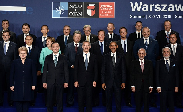(Front row, L-R) Lithuania's President Dalia Grybauskaite, Polish President Andrzej Duda, NATO Secretary General Jens Stoltenberg, US President Barack Obama, Afghanistan's President Ashraf Ghani and Afghanistan's Chief Executive Abdullah Abdullah pose along with other leaders for a family photo during a NATO summit in Warsaw, Poland. The Polish capital Warsaw hosts a two-day top-level NATO meeting, for the first time since Poland joined the alliance in 1999. / AFP / STEPHANE DE SAKUTIN (Photo credit should read STEPHANE DE SAKUTIN/AFP/Getty Images)