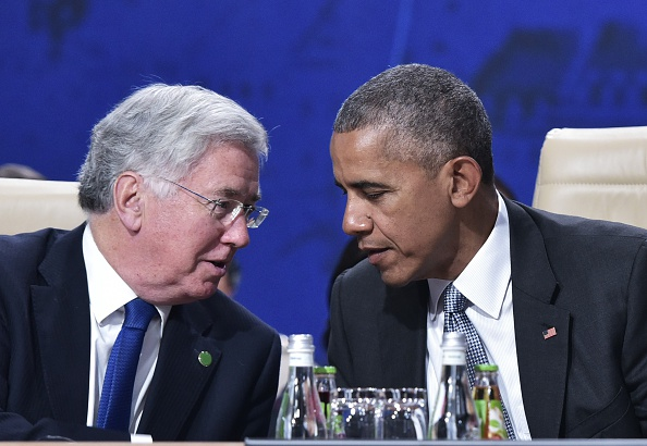 US President Barack Obama (R) talks with Britain's Secretary of State for Defence Michael Fallon (L) during a NATO summit session on Afghanistan at the Polish National Stadium in Warsaw, Poland on July 9, 2016. The Polish capital hosts a two-day NATO summit, the first time ever that it hosts a top-level meeting of the Western military alliance which it joined in 1999. / AFP / MANDEL NGAN (Photo credit should read MANDEL NGAN/AFP/Getty Images)