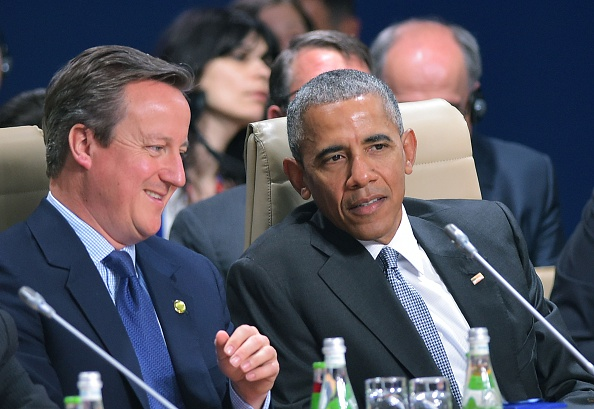 US President Barack Obama (L) and Britain's Prime Minister David Cameron chat during a working session working session of the North Atlantic Council during the NATO Summit in Warsaw on July 9, 2016. The Polish capital Warsaw hosts a two-day top-level NATO meeting for the first time since Poland joined the alliance in 1999. / AFP / MANDEL NGAN (Photo credit should read MANDEL NGAN/AFP/Getty Images)