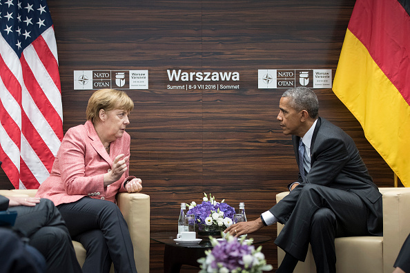 WARSAW, POLAND - JULY 09: In this handout photo provided by the German Government Press Office (BPA), German Chancellor Angela Merkel and President Barack Obama meet for talks during the Warsaw NATO Summit on July 9, 2016 in Warsaw, Poland. NATO member heads of state, foreign ministers and defense ministers are gathering for a two-day summit that will end later today. (Photo by Guido Bergmann/Bundesregierung via Getty Images)