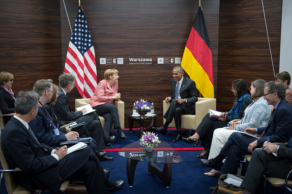 WARSAW, POLAND - JULY 09: In this handout photo provided by the German Government Press Office (BPA), German Chancellor Angela Merkel and President Barack Obama along with their interpreters and advisers meet for talks during the Warsaw NATO Summit on July 9, 2016 in Warsaw, Poland. NATO member heads of state, foreign ministers and defense ministers are gathering for a two-day summit that will end later today. (Photo by Guido Bergmann/Bundesregierung via Getty Images)