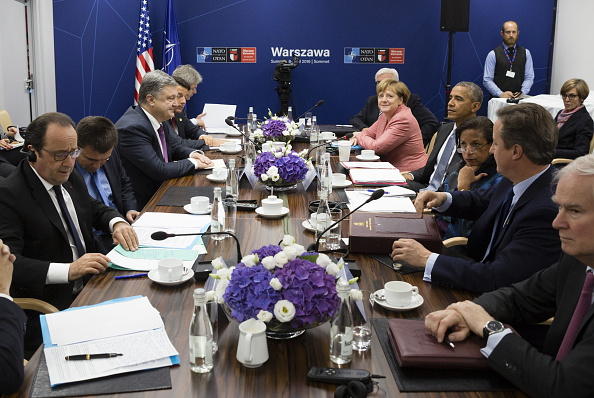 WARSAW, POLAND - JULY 9, 2016: France's President Francois Hollande (L), Ukraine's President Petro Poroshenko (3rd L), Italy's Prime Minister Matteo Renzi (4th L), UK Prime Minister David Cameron (2nd R), US President Barack Obama (4th R), Germany's Chancellor Angela Merkel (5th R) during a meeting as part of a NATO summit. Mikhail Palinchak/Press Office of the President of Ukraine/TASS (Photo by Mikhail PalinchakTASS via Getty Images)