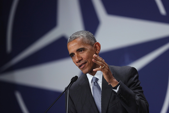 WARSAW, POLAND - JULY 09: U.S. President Barack Obama speaks to the media in front of the NATO logo at the conclusion of the Warsaw NATO Summit on July 9, 2016 in Warsaw, Poland. NATO member heads of state, foreign ministers and defense ministers had gathered for a two-day summit that ended today. (Photo by Sean Gallup/Getty Images)