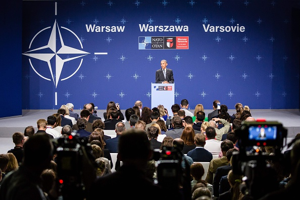 US President Barack Obama attends a press conference during the second day of the NATO Summit at the Polish National Stadium in Warsaw on July 9, 2016. The Polish capital hosts a two-day NATO summit, the first time ever that it hosts a top-level meeting of the Western military alliance which it joined in 1999. / AFP / AFP PHOTO / WOJTEK RADWANSKI (Photo credit should read WOJTEK RADWANSKI/AFP/Getty Images)