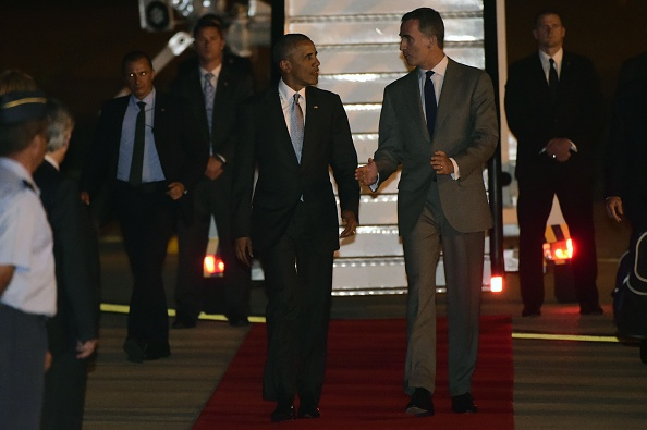 US President Barack Obama (CL) walks with Spain's King Felipe VI on arrival at the Torrejon airbase near Madrid on July 9, 2016. Barack Obama began a shortened but symbolic first presidential trip to Spain Saturday, squeezing in a visit to a key ally before dashing home to deal with the aftermath of wrenching shooting in Dallas / AFP / PIERRE-PHILIPPE MARCOU (Photo credit should read PIERRE-PHILIPPE MARCOU/AFP/Getty Images)