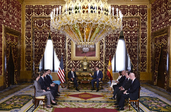 US President Barack Obama (L) takes part in a bilateral meeting with Spain's King Felipe (R) at the Palacio Real de Madrid in Madrid, Spain on July 10, 2016. Obama said he will cut short a foreign trip and visit Dallas next week as the shooting rampage by the black army veteran, who said he wanted to kill white cops, triggered urgent calls to mend troubled race relations in the United States. / AFP / MANDEL NGAN (Photo credit should read MANDEL NGAN/AFP/Getty Images)