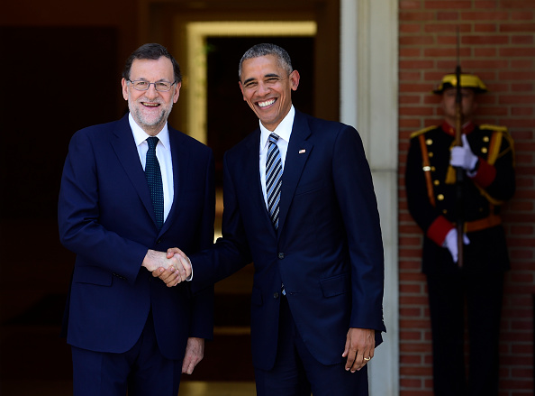 Spanish Prime Minister Mariano Rajoy (L) shakes hand with US president Barack Obama at Moncloa palace in Madrid on July 10, 2016. Obama said he will cut short a foreign trip and visit Dallas next week as the shooting rampage by the black army veteran, who said he wanted to kill white cops, triggered urgent calls to mend troubled race relations in the United States. / AFP / PIERRE-PHILIPPE MARCOU (Photo credit should read PIERRE-PHILIPPE MARCOU/AFP/Getty Images)