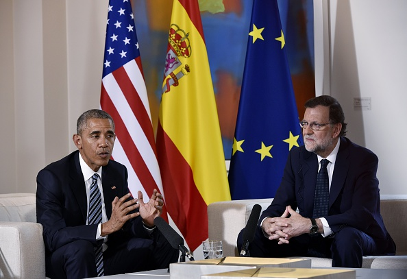 US President Barack Obama (L) speaks with Spain's interim prime minister Mariano Rajoy during a bilateral meeting at Moncloa palace in Madrid on July 10, 2016. Obama said he will cut short a foreign trip and visit Dallas next week as the shooting rampage by the black army veteran, who said he wanted to kill white cops, triggered urgent calls to mend troubled race relations in the United States. / AFP / Mandel Ngan (Photo credit should read MANDEL NGAN/AFP/Getty Images)