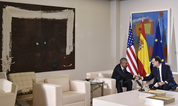 US President Barack Obama (L) shakes hands with Spain's interim prime minister Mariano Rajoy during a bilateral meeting at Moncloa palace in Madrid on July 10, 2016. Obama said he will cut short a foreign trip and visit Dallas next week as the shooting rampage by the black army veteran, who said he wanted to kill white cops, triggered urgent calls to mend troubled race relations in the United States. / AFP / Mandel Ngan (Photo credit should read MANDEL NGAN/AFP/Getty Images)