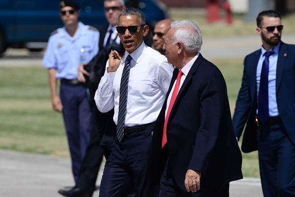 Spanish Minister of Foreign Affairs and Cooperation Jose Garcia-Margallo (2ndR) accompanies US president Barack Obama (L) on his way to his plane at Torrejon de Ardoz airport on July 10, 2016. Obama said he will cut short a foreign trip and visit Dallas next week as the shooting rampage by the black army veteran, who said he wanted to kill white cops, triggered urgent calls to mend troubled race relations in the United States. / AFP / JAVIER SORIANO (Photo credit should read JAVIER SORIANO/AFP/Getty Images)