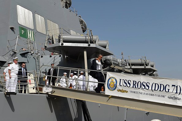 US President Barack Obama (C) leaves the USS Ross Navy ship after a visit on board, at the Naval Station Rota, in Rota, southwestern Spain on July 10, 2016. Obama said he will cut short a foreign trip and visit Dallas next week as the shooting rampage by the black army veteran, who said he wanted to kill white cops, triggered urgent calls to mend troubled race relations in the United States. / AFP / MANDEL NGAN (Photo credit should read MANDEL NGAN/AFP/Getty Images)