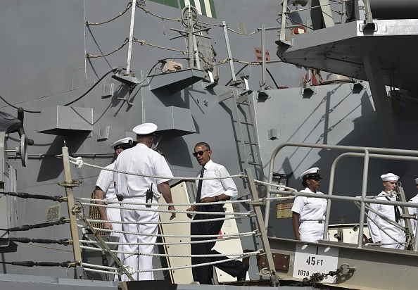US President Barack Obama (C) arrives to tour the USS Ross Navy ship at the Naval Station Rota, in Rota, southwestern Spain on July 10, 2016. Obama said he will cut short a foreign trip and visit Dallas next week as the shooting rampage by the black army veteran, who said he wanted to kill white cops, triggered urgent calls to mend troubled race relations in the United States. / AFP / Mandel Ngan (Photo credit should read MANDEL NGAN/AFP/Getty Images)