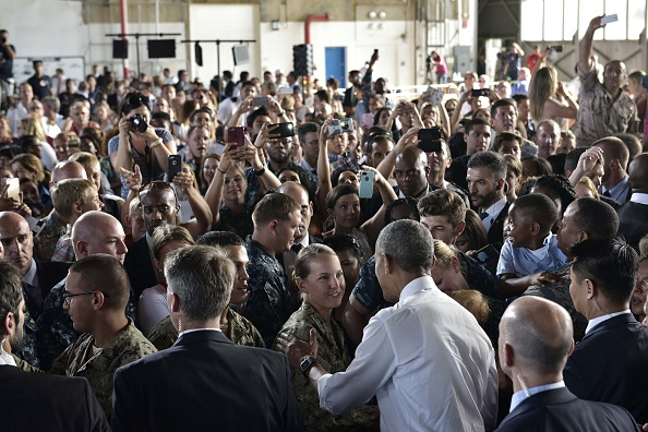 US President Barack Obama (3rdR) greets attendees after speaking to service members at the Naval Station Rota, in Rota, southwestern Spain on July 10, 2016. Obama said he will cut short a foreign trip and visit Dallas next week as the shooting rampage by the black army veteran, who said he wanted to kill white cops, triggered urgent calls to mend troubled race relations in the United States. / AFP / MANDEL NGAN (Photo credit should read MANDEL NGAN/AFP/Getty Images)