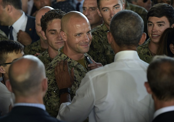 US President Barack Obama (R) greets attendees after speaking to service members at the Naval Station Rota, in Rota, southwestern Spain on July 10, 2016. Obama said he will cut short a foreign trip and visit Dallas next week as the shooting rampage by the black army veteran, who said he wanted to kill white cops, triggered urgent calls to mend troubled race relations in the United States. / AFP / Mandel NGAN (Photo credit should read MANDEL NGAN/AFP/Getty Images)