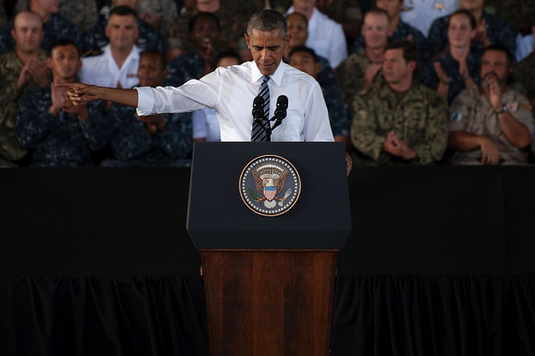 US president Barack Obama gestures as he speaks to service members at the Naval Station Rota, in Rota, southwestern Spain on July 10, 2016 Obama said he will cut short a foreign trip and visit Dallas next week as the shooting rampage by the black army veteran, who said he wanted to kill white cops, triggered urgent calls to mend troubled race relations in the United States. / AFP / JORGE GUERRERO (Photo credit should read JORGE GUERRERO/AFP/Getty Images)